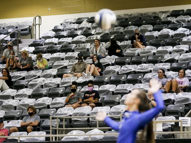 Volleyball spectators look on while social distancing with seats cordoned off with plastic bags during a high school volleyball match between Lindale and Kaufman at Kaufman High School, Tuesday, August 11, 2020.