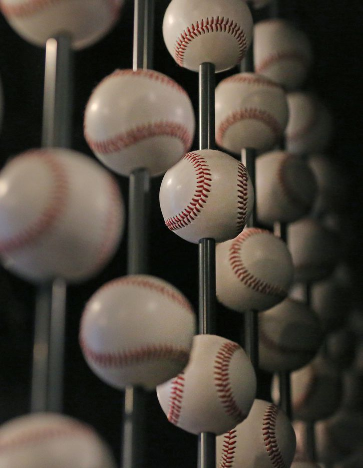 Baseballs form a backdrop for a display at the Baseball Hall of Fame in Cooperstown, N.Y., photographed on Tuesday, May 30, 2017.