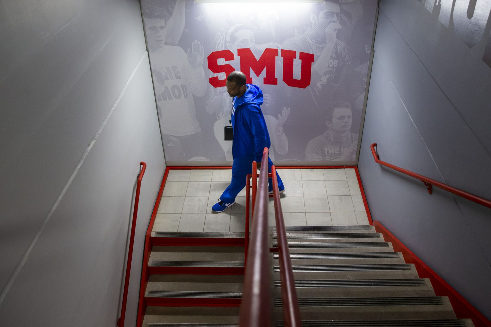Travis Mays, head coach of Southern Methodist University women's basketball, walks down a flight a stairs to attend a team practice at the SMU Crum Basketball Center. (Lynda M. Gonzalez/The Dallas Morning News)