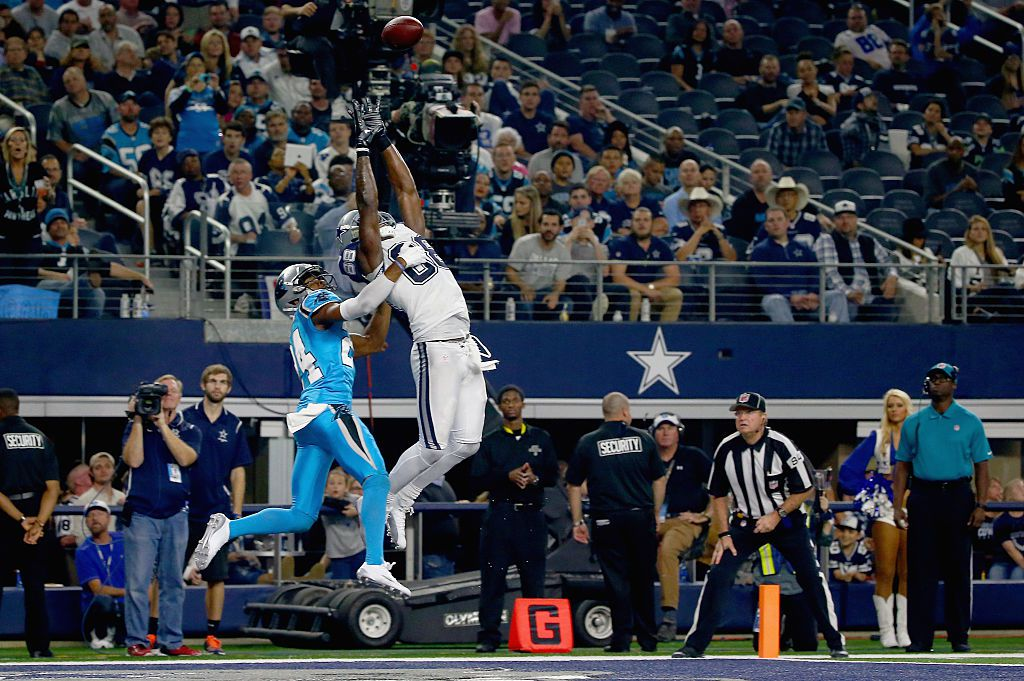 ARLINGTON, TX - NOVEMBER 26: Dez Bryant #88 of the Dallas Cowboys bobbles a ball in the edn zone against Josh Norman #24 of the Carolina Panthers at AT&T Stadium on November 26, 2015 in Arlington, Texas. (Photo by Tom Pennington/Getty Images)