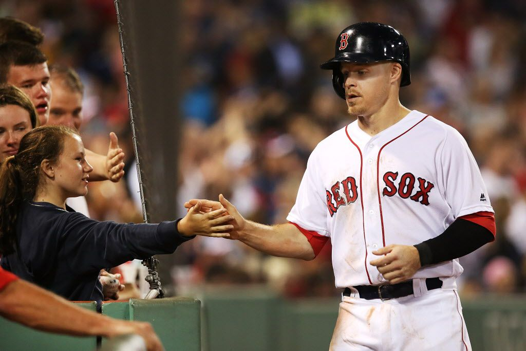 FILE - Brock Holt of the Red Sox high-fives teammates after scoring in the fourth inning of a game against the Rangers on July 5, 2016, at Fenway Park in Boston. (Photo by Adam Glanzman/Getty Images)