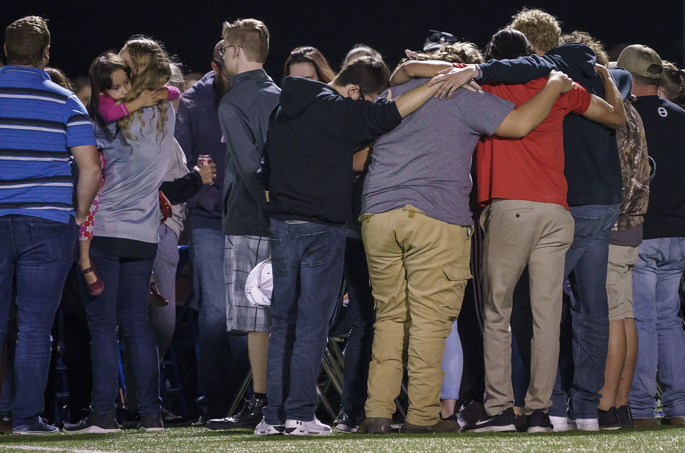 Mourners gather at the Community ISD football stadium for a vigil for four students who were killed in a two-vehicle crash on Wednesday, Nov. 6, 2019, in Nevada, Texas.