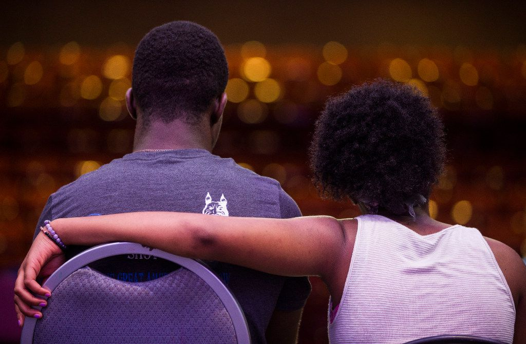 Trinity Gordon, 17, right, wraps her arm around Deaveyon Murphy, 18, while rehearsing a scene June 30, 2017 at Eastfield College in Mesquite, Texas.
