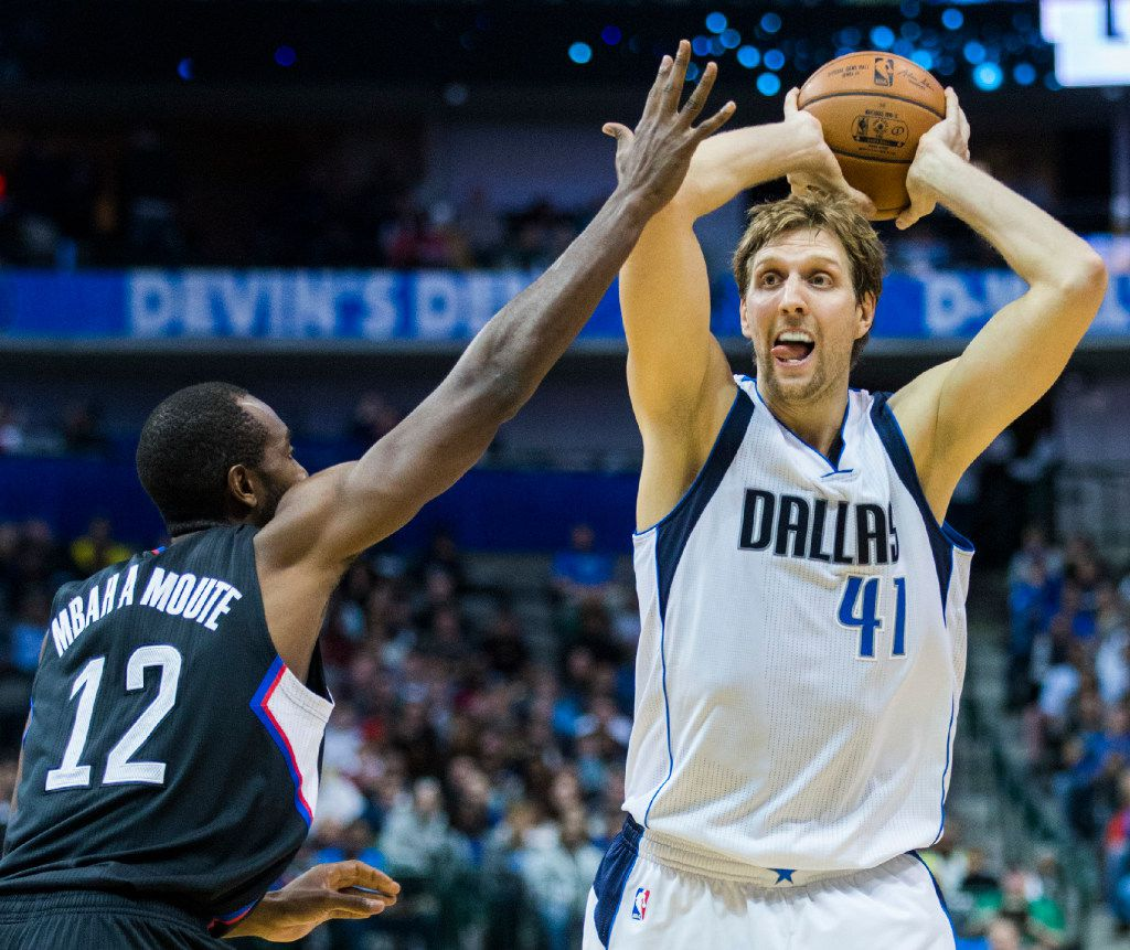 Dallas Mavericks forward Dirk Nowitzki (41) passes the ball over LA Clippers forward Luc Mbah a Moute (12) during the second quarter of their game on Wednesday, November 23, 2016 at the American Airlines Center in Dallas.  (Ashley Landis/The Dallas Morning News)