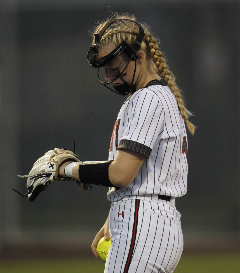 Lovejoy pitcher Jade Owens (7) checks a sign before delivering a pitch to a Hallsville batter during the top of the 3rd inning of play. Game 2 of a best-of-3 Class 5A Region ll final series softball playoff game was  held at Rockwall High School in Rockwall on May 27, 2021. (Steve Hamm/ Special Contributor)