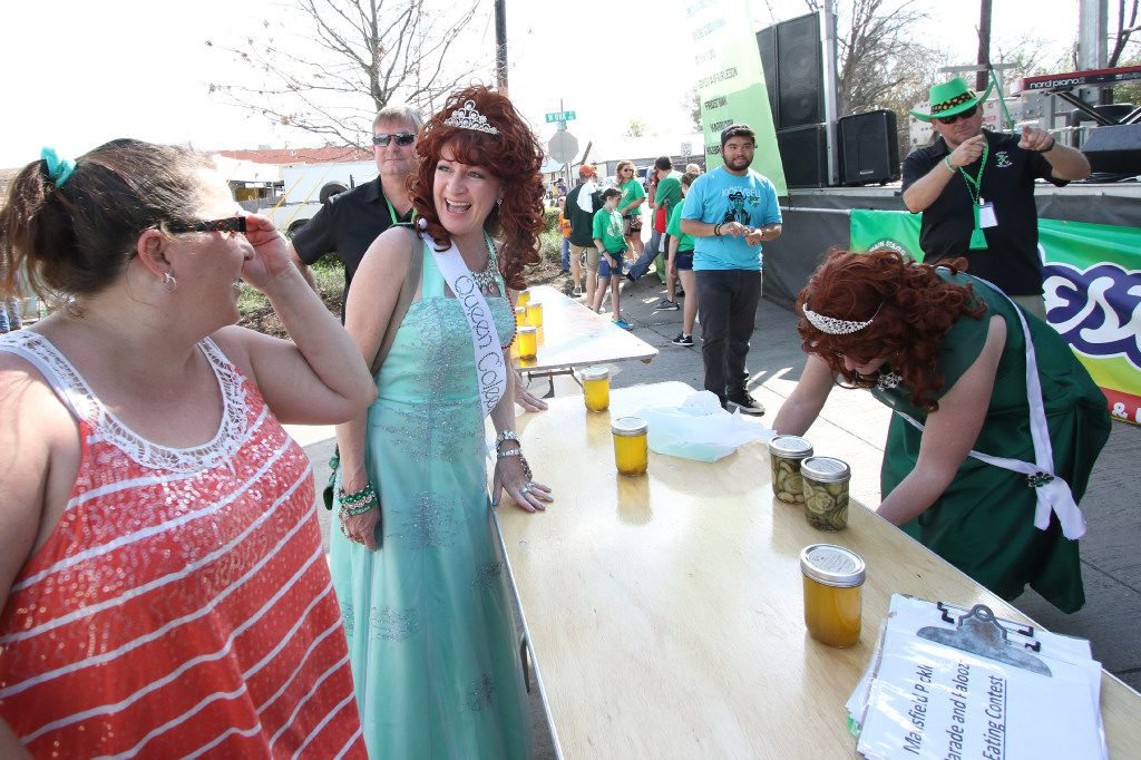 Coleen Daniell, of Mansfield, a six year veteran pickle queen, greets a contestant prior to the start of the annual pie eating contest. A number of  contests and events were held in conjunction with the City of Mansfield's St. Patrick's Day celebration including the annual St. Paddy's Pickle Parade and Palooza. The events were held along the downtown Main Street area in Mansfield on March 18, 2017. (Steve Hamm/Special Contributor)