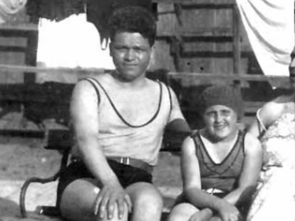 This rare pre-World War II photo, circa 1928, shows 21-year-old Victor Capesius, left, relaxing at a public pool with a Jewish family in his Romanian hometown.