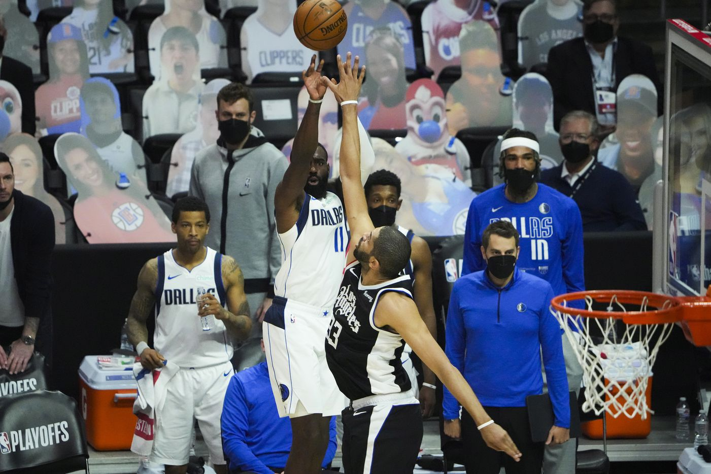 Dallas Mavericks forward Tim Hardaway Jr. (11) shoots a 3-pointer over LA Clippers forward Nicolas Batum (33) during the second quarter of Game 7 of an NBA playoff series at the Staples Center on Sunday, June 6, 2021, in Los Angeles.