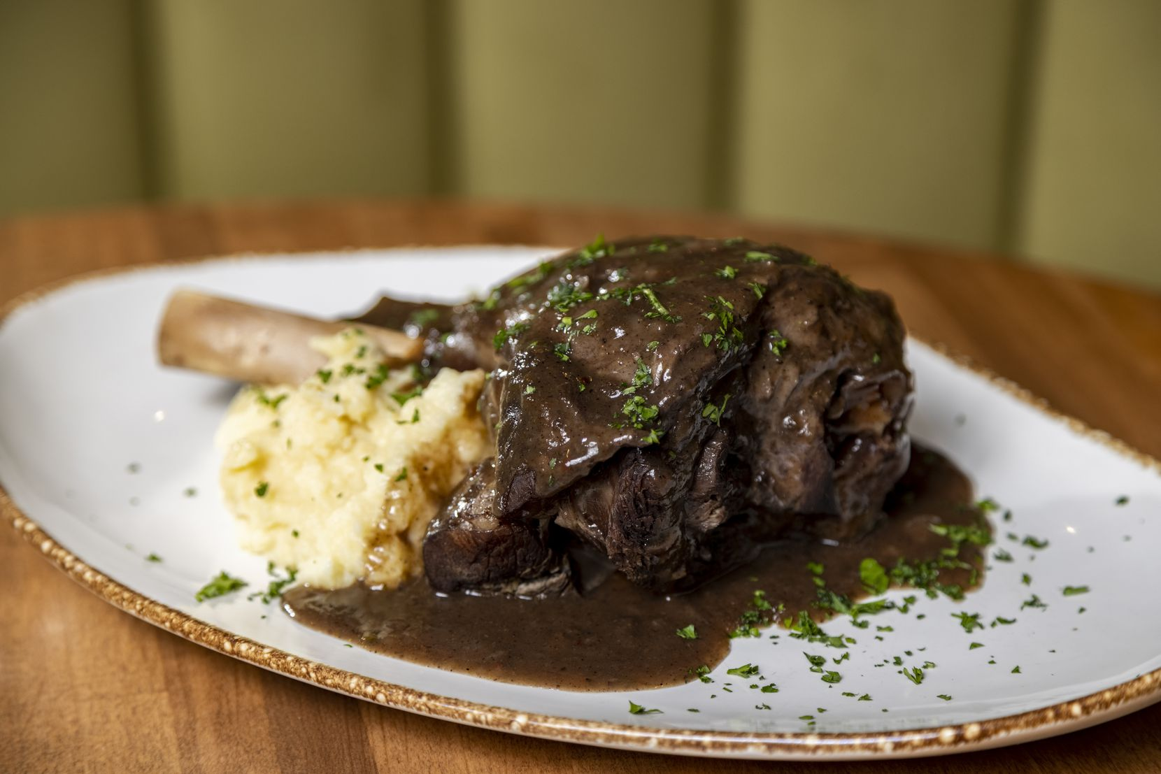 Jerk Roasted Lamb Shank with mashed potatoes at Pangea Restaurant in Garland