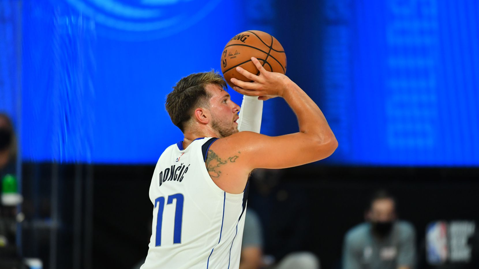 Orlando, FL - JULY 26: Luka Doncic #77 of the Dallas Mavericks shoots a free-throw during a scrimmage against the Indiana Pacers on July 26, 2020 at HP Field House at ESPN Wide World of Sports in Orlando, Florida.
