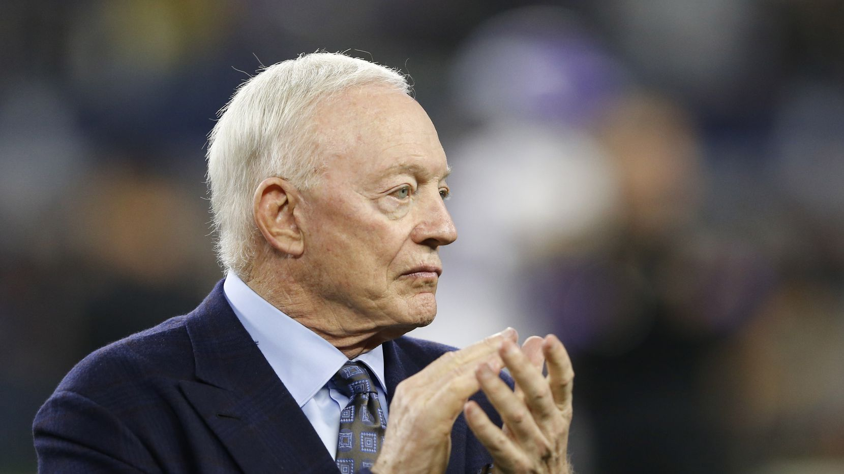 Dallas Cowboys owner Jerry Jones claps as the team takes the field for warmups before a game against the Minnesota Vikings in Arlington, Texas on Sunday, November 10, 2019.