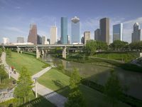 Downtown Houston skyline and Buffalo Bayou, which stretches 52 miles through Houston, from the mouth of the Houston Ship Channel to the forests of Memorial Park.