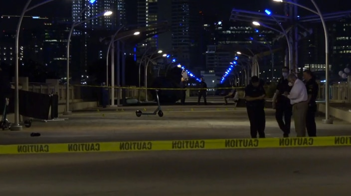 Dallas Police detectives on the scene of an early morning shooting on Saturday, July 11, on the Ronald Kirk pedestrian bridge near Trinity Groves.