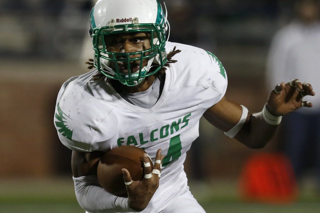 Lake Dallas Falcons  Courtenay Holder runs with the ball to score a touchdown in the 3rd quarter as Lake Dallas faces Frisco Lone Star at Eagle Stadium in Allen on Friday, Dec. 11, 2015. (Rachel Woolf/The Dallas Morning News)