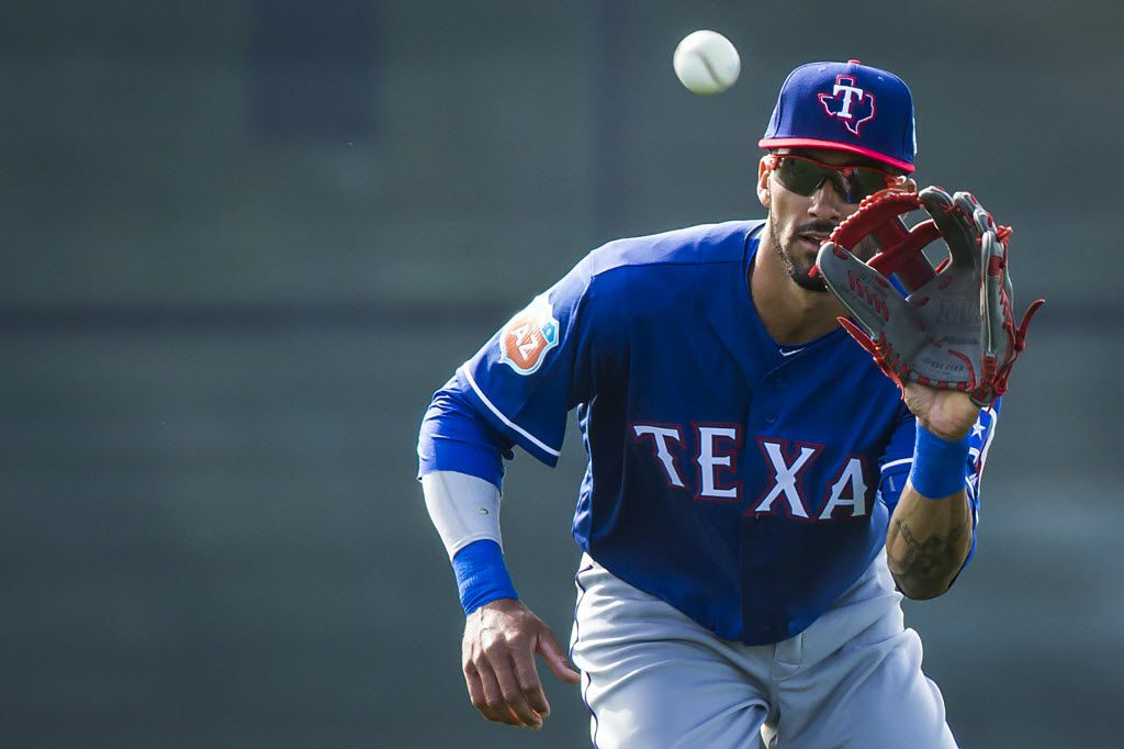 Texas Rangers outfielder Ian Desmond catches a fly ball while participating in a fielding drill during a spring workout at the team's training facility on Monday, Feb. 29, 2016, in Surprise, Ariz. (Smiley N. Pool/The Dallas Morning News)