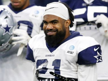 Dallas Cowboys running back Ezekiel Elliott (21) smiles during training camp at the Dallas Cowboys headquarters at The Star in Frisco, Texas on Monday, August 17, 2020. (Vernon Bryant/The Dallas Morning News)