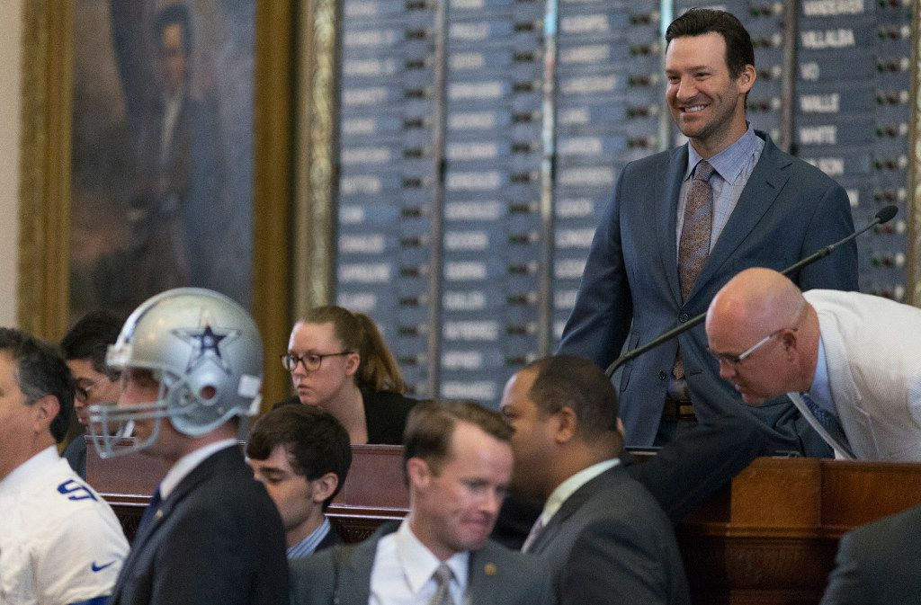 Former Dallas Cowboys quarterback Tony Romo smiles as he is recognized by the House at the Texas Capitol in Austin, Wednesday, May 3, 2017.