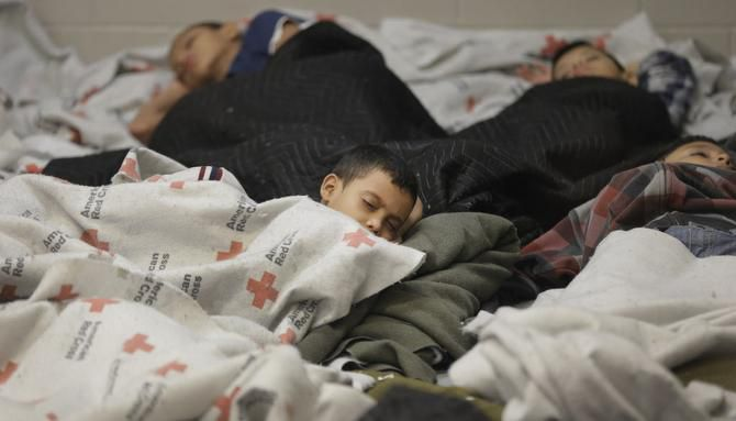 Detainees sleep in a holding cell at a U.S. Customs and Border Protection processing facility June 18 in Brownsville.