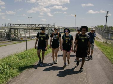 Marchers for the Sunrise Movement Kashish Bastola (left), Audrey Lin (center left), Amalia Hochman (center right) and Kidus Girma (right) make their way through Louisiana on their 400-mile journey from New Orleans to Houston.