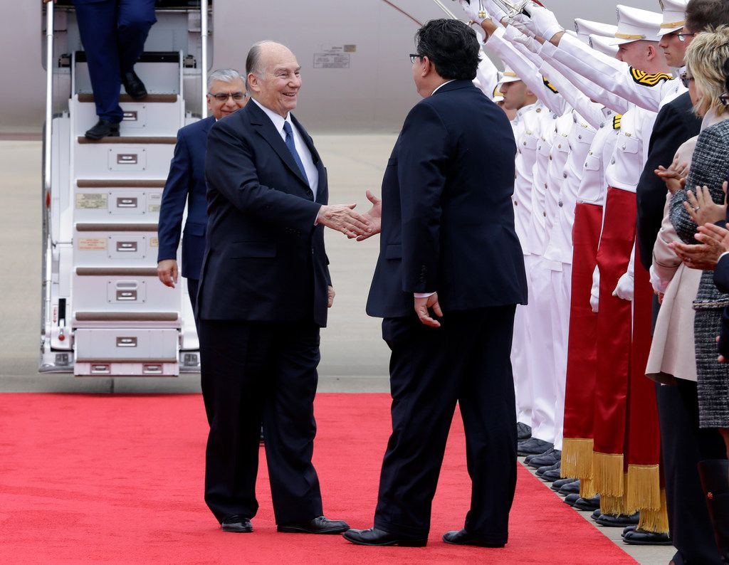 The Aga Khan (left) shakes hands with Texas Secretary of State Rolando Pablos during his arrival.