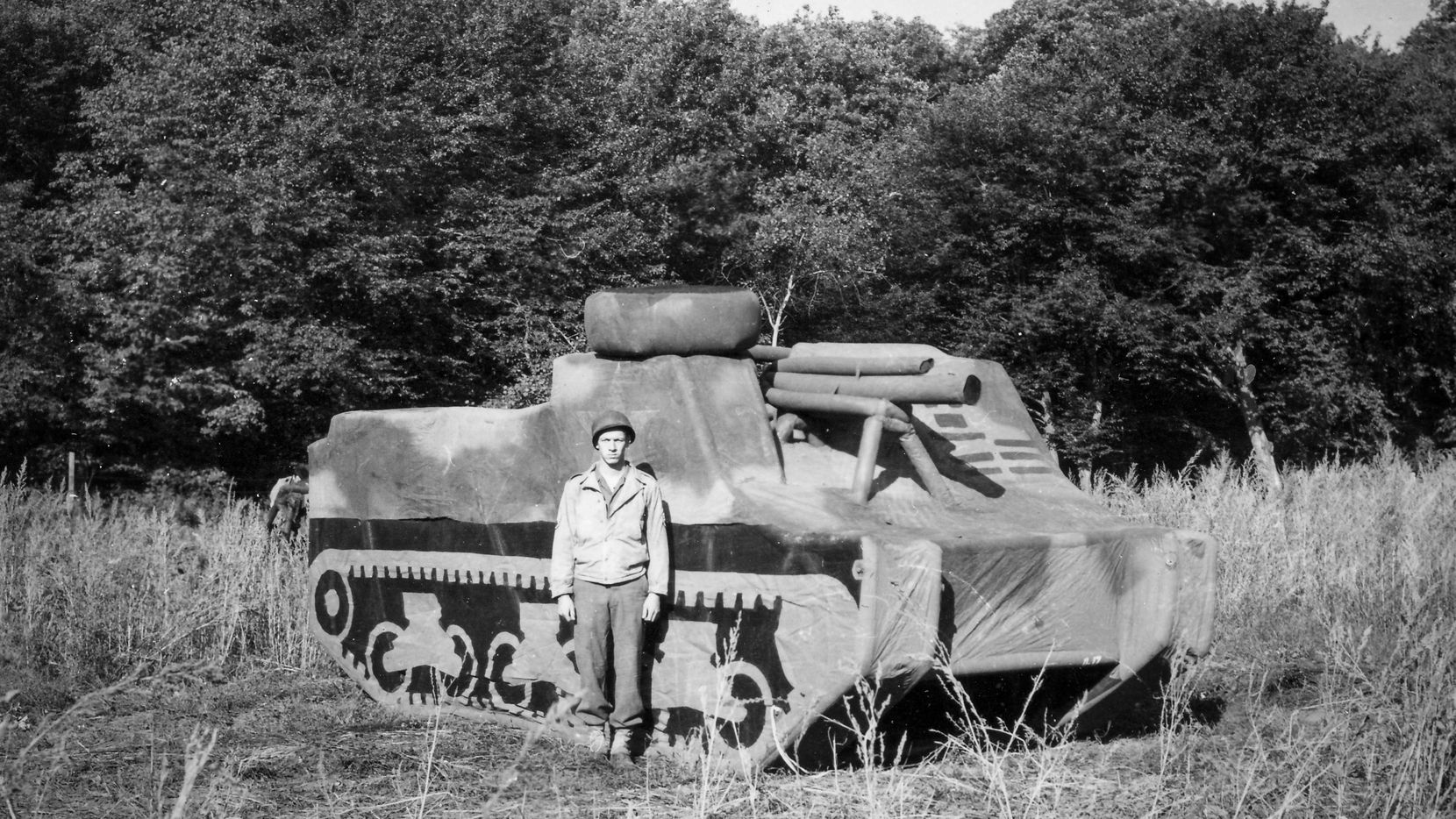 A soldier stands in front of an inflatable tank that he used as a member of the Ghost Army in World War II to trick Germans into thinking the Allies were closing in.