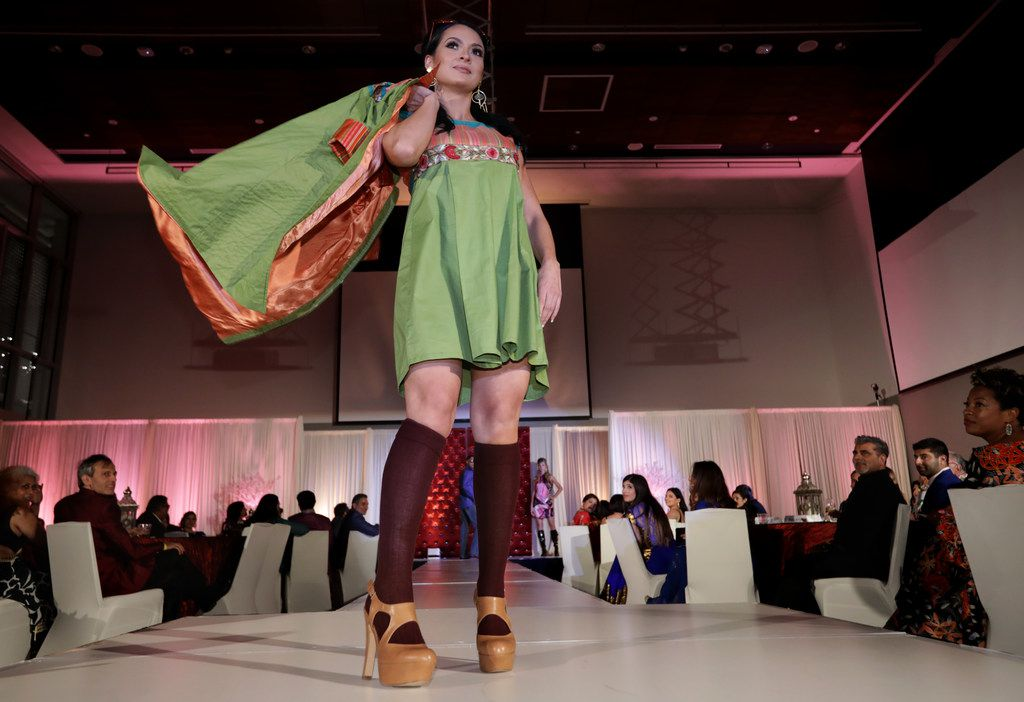 Models walk the runway during the Bollywood to Hollywood charity gala at the University of Texas at Dallas' Davidson-Gundy Alumni Center in Richardson. (Jason Janik/Special Contributor)