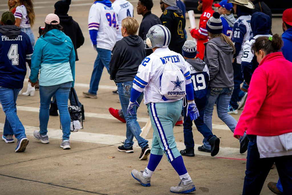 Dallas Cowboys Mark Wilhite of Amarillo heads to the stadium as fans tailgate before an NFL football game between the Cowboys and the Buffalo Bills at AT&T Stadium on Thursday, Nov. 28, 2019, in Arlington. (Smiley N. Pool/The Dallas Morning News)