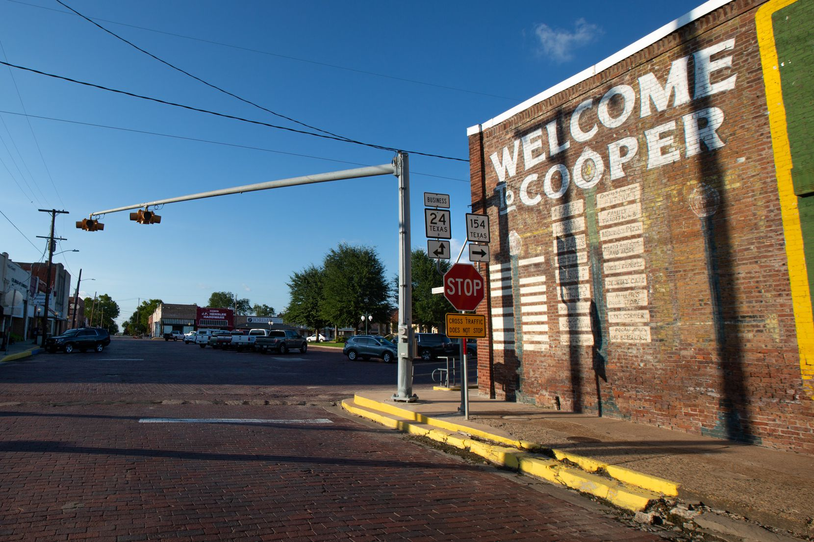 A sign welcomes visitors to the downtown square of Cooper, Texas, on July 11, 2019.