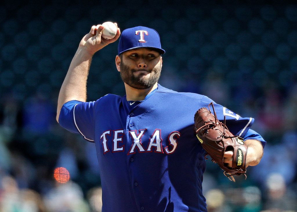 Texas Rangers starting pitcher Lance Lynn throws against the Seattle Mariners in the first inning of a baseball game Sunday, April 28, 2019, in Seattle. (AP Photo/Elaine Thompson)