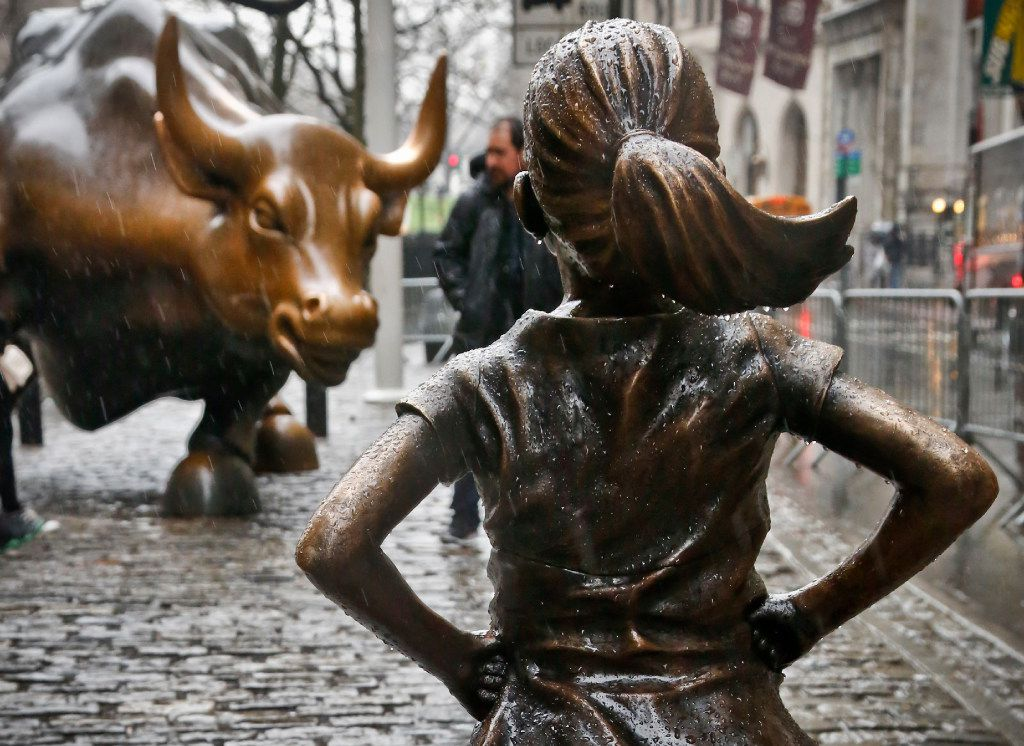"The ""Fearless Girl"" statue, created by Kristen Visbal, stands across from the ""Charging Bull"" statue in New York."