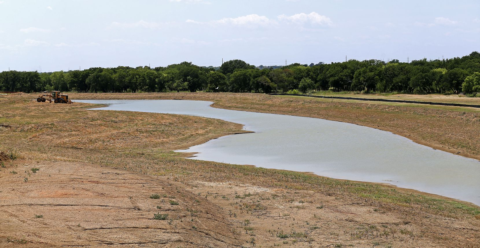 The Crystal Lagoon under construction in Prosper's Windsong Ranch will open next spring.
