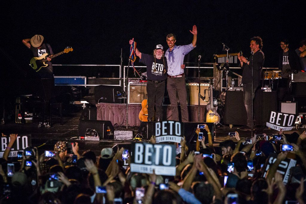 Rep. Beto O'Rourke, D-El Paso, joined by singer Willie Nelson, waves to supporters at a campaign rally at Auditorium Shores on Sept. 29, 2018 in Austin.