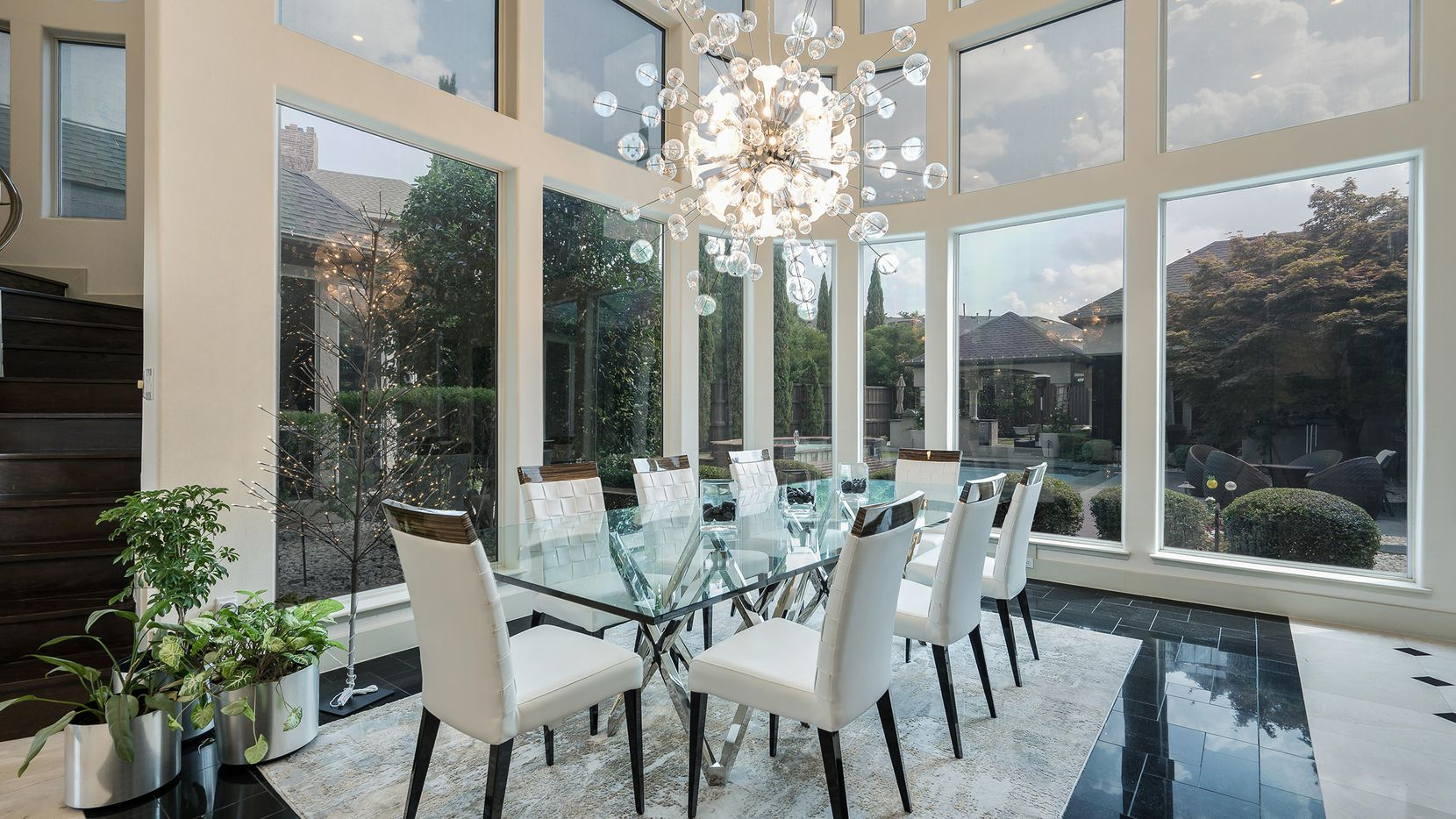 The estate at 3509 Cedar Falls Lane in Plano features large windows with panoramic views.