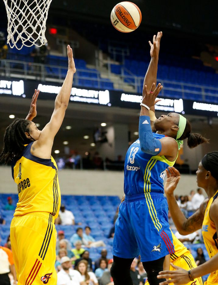 Dallas Wings guard Karima Christmas-Kelly (13) makes a shot over Indiana Fever forward Candice Dupree (4) during the first half at at College Park Center in Arlington, Texas, Tuesday, May 30, 2017. (Jae S. Lee/The Dallas Morning News)