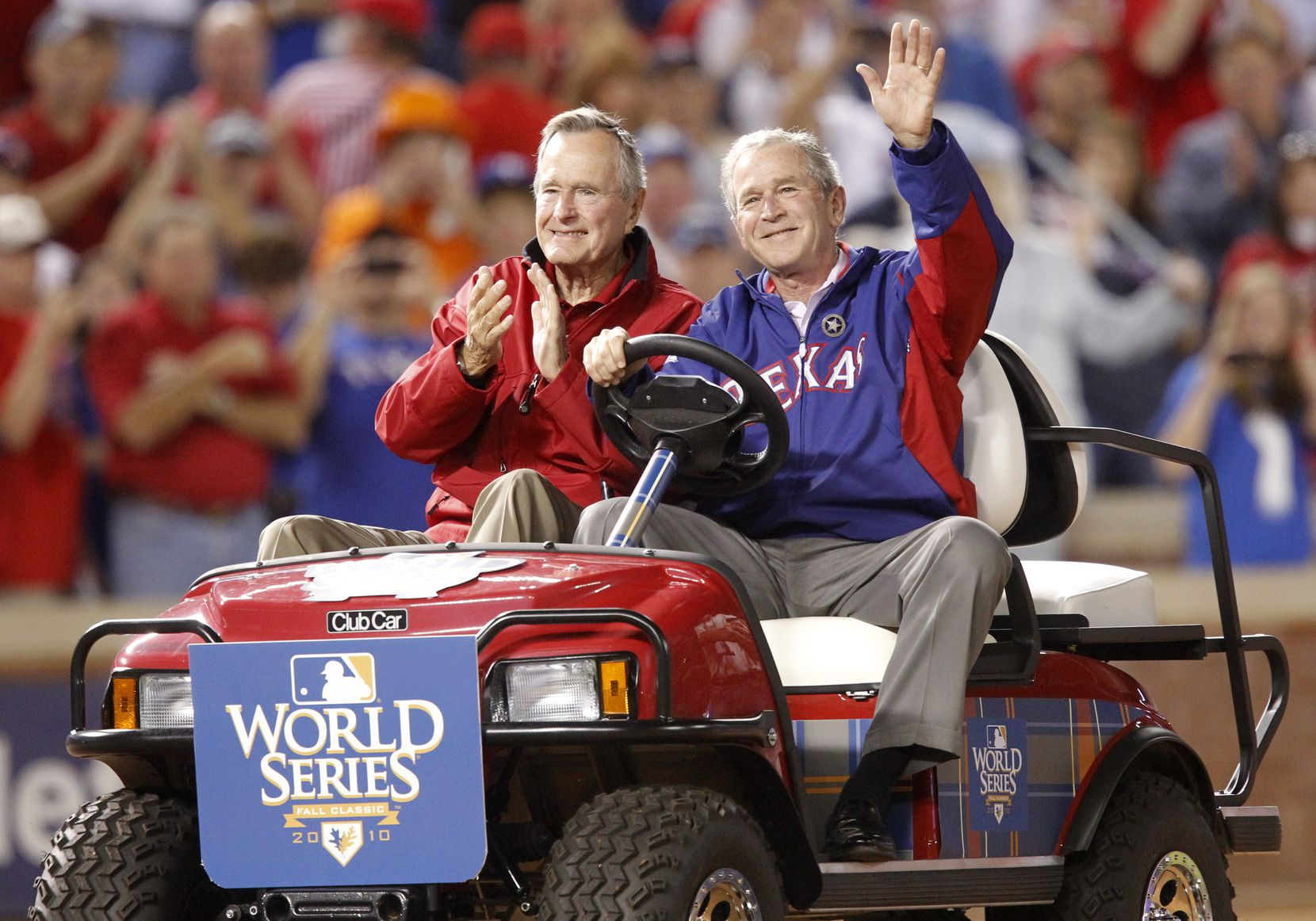 2010: Former Presidents George H.W. Bush and his son George W. Bush acknowledge the crowd before George W. Bush threw the ceremonial first pitch for Game 4 of the World Series between the San Francisco Giants and the Texas Rangers in Arlington.
