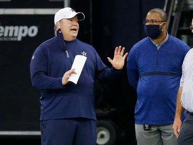 Dallas Cowboys head coach Mike McCarthy talks with Dallas Cowboys vice president of player personnel Will McClay and Dallas Cowboys executive vice president Stephen Jones during training camp at the Dallas Cowboys headquarters at The Star in Frisco, Texas on Friday, August 28, 2020.