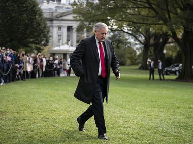 White House Chief of Staff Mark Meadows walks along the South Lawn on Oct. 30.