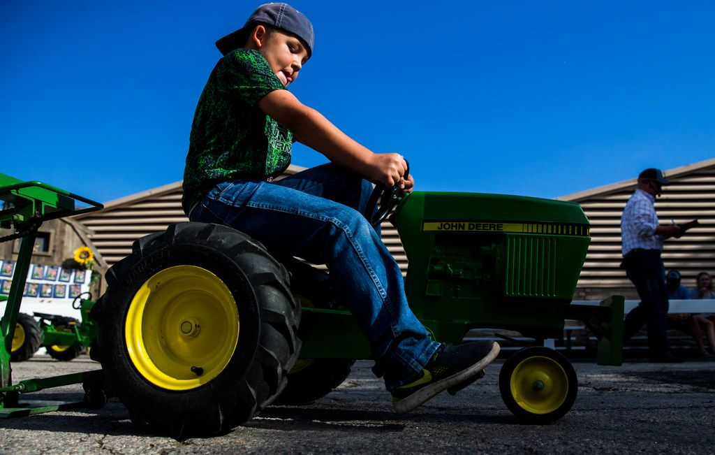 Wyatt Luddeke, 9, of Cuero competes in the Kids' Pedal Tractor Pull at the State Fair of Texas  in 2017.