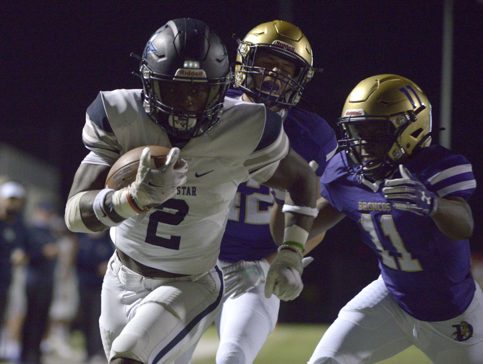 Lone Star's Ashton Jeanty (2) runs for a touchdown in front of Denton's Amir Fera (42) and Courtney Blackston (11) in the second quarter of a high school football game between Frisco Lone Star and Denton, Thursday, Nov. 5, 2020, in Denton, Texas.