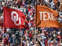The Longhorn carries the flags of both schools before an NCAA football game between Texas and Oklahoma at the Cotton Bowl on Saturday, Oct. 12, 2019, in Dallas.