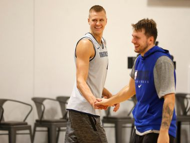 Dallas Mavericks forward Kristaps Porzingis (6) and Dallas Mavericks forward Luka Doncic (77) during a three point shootout during training camp practice at the Dallas Mavericks practice facility in Dallas on Wednesday, October 2, 2019.