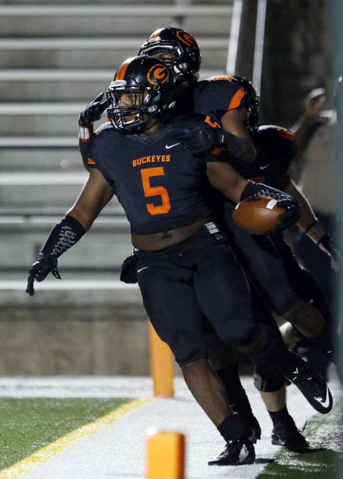 (TXHSFB) Gilmer High RB DeMarco Boyd (5) celebrates his touchdown during the first quarter of a high school football playoff game against Celina Highon Friday, December 11, 2014. (John F. Rhodes / Special Contributor)