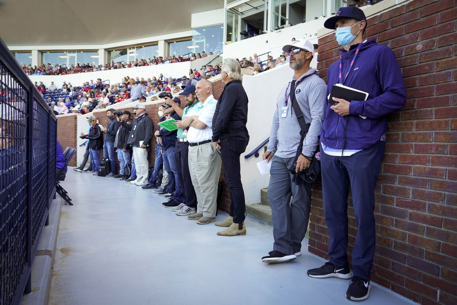 MLB scouts line the concourse to watch an NCAA baseball game between Mississippi and Vanderbilt at Swayze Field on Friday, May 14, 2021, in Oxford, Miss.