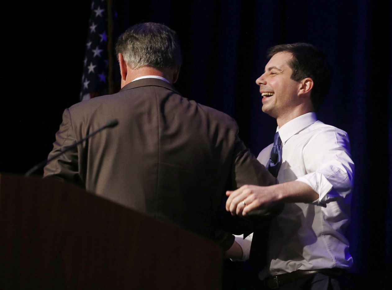 Dallas mayor Mike Rawlings and Presidential candidate and South Bend mayor Pete Buttigieg share a laugh as Rawlings introduced Buttigieg to speak during the Dallas County Democratic Party's annual dinner at the Hilton Anatole Hotel in Dallas on Friday, May 3, 2019.