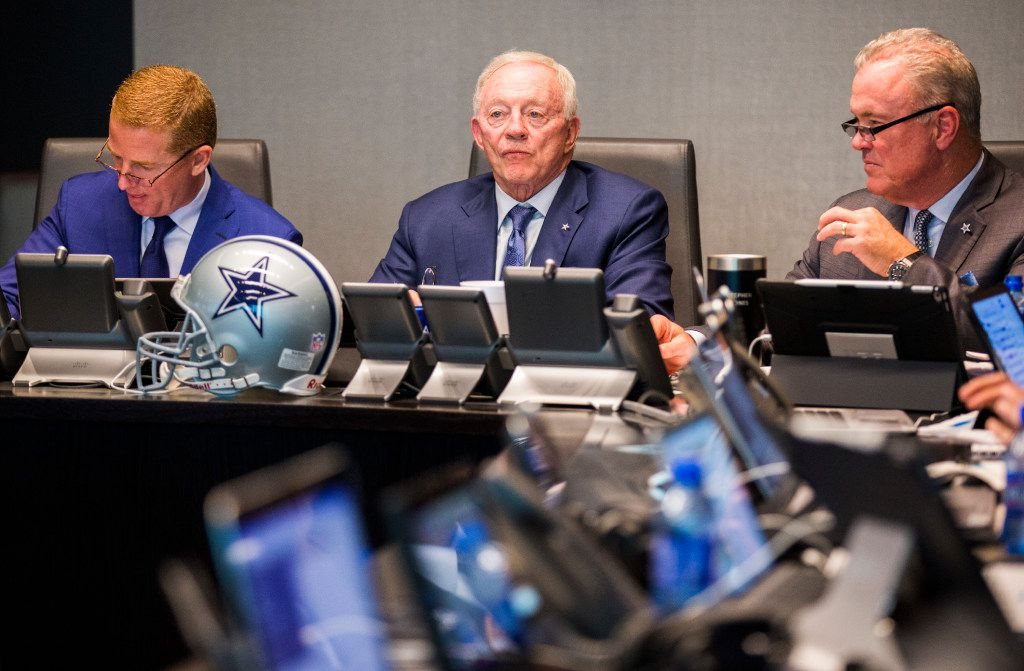 Dallas Cowboys head coach Jason Garrett, owner Jerry Jones and Executive Vice President and CEO Stephen Jones discuss players in the war room during round one of the 2017 NFL Draft on Thursday, April 27, 2017 at The Star in Frisco, Texas. (Ashley Landis/The Dallas Morning News)