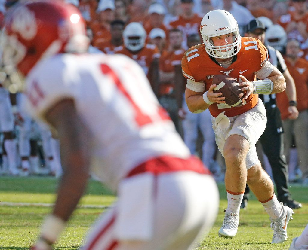 Texas Longhorns quarterback Sam Ehlinger (11) is pictured during the Oklahoma University Sooners vs. the University of Texas Longhorns NCAA college football game at the Cotton Bowl in Dallas on Saturday, October 14, 2017. (Louis DeLuca/The Dallas Morning News)