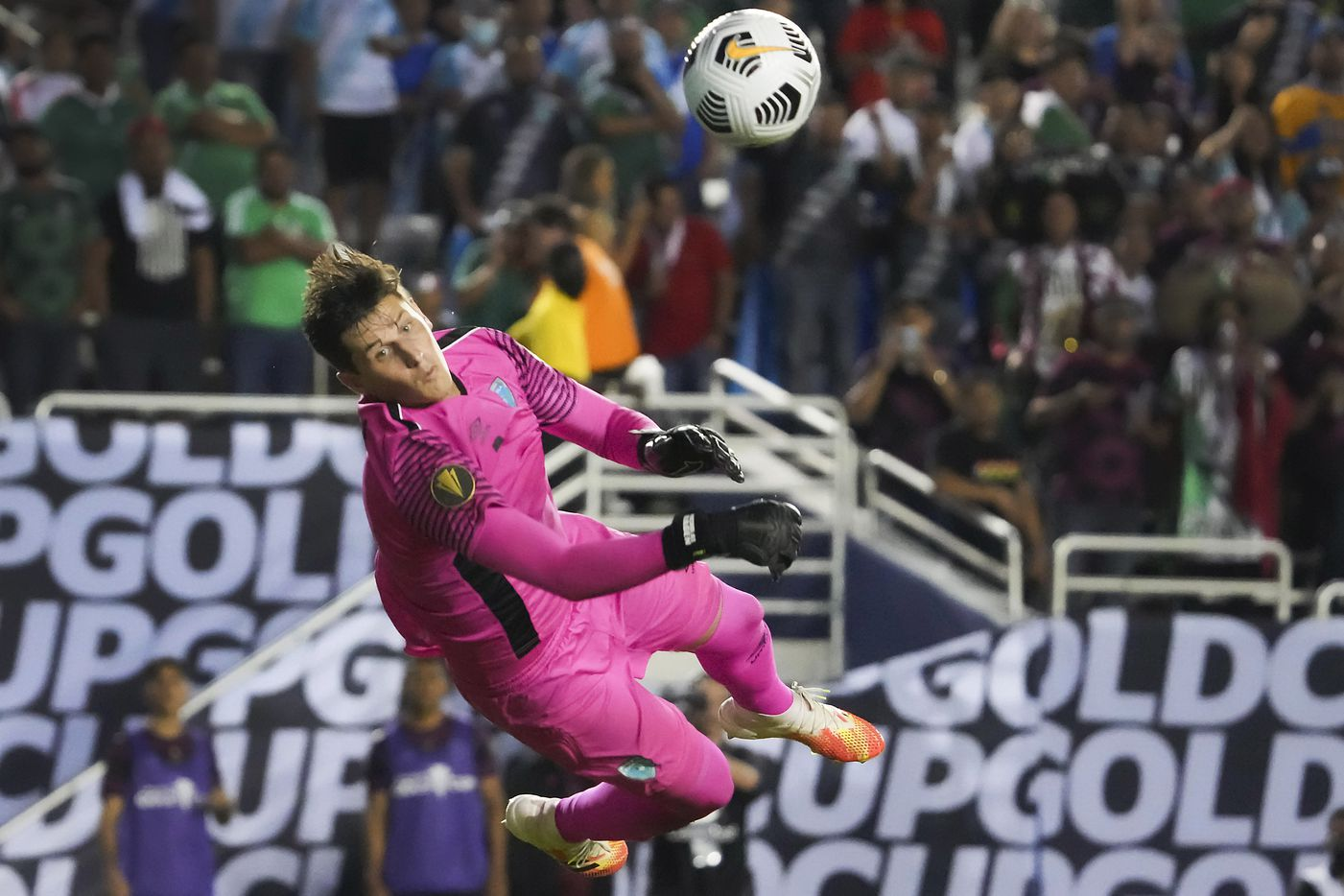 Guatemala goalkeeper Nicholas Hagen dives to knock away a Mexico shot during the second half of a CONCACAF Gold Cup Group A soccer match at the Cotton Bowl on Wednesday, July 14, 2021, in Dallas.