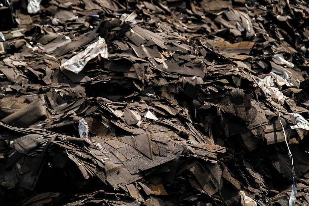 A closeup view of the mountain of roofing shingles at Blue Star Recycling.