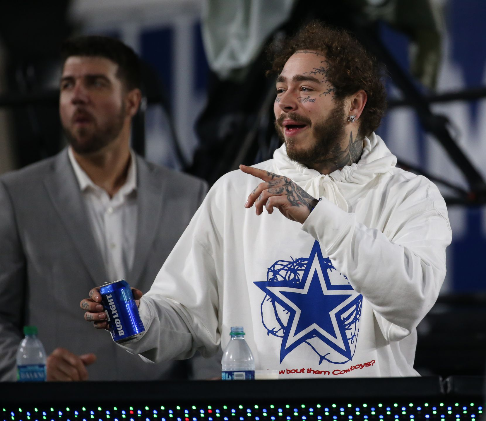 In this Jan. 12, 2019 file photo, Post Malone watches the Dallas Cowboys and Los Angeles Rams in the first quarter of the NFC divisional round playoff game at Los Angeles Memorial Coliseum in Los Angeles, Calif.