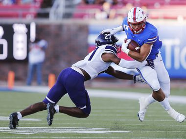 Southern Methodist Mustangs tight end Kylen Granson (83) stiff arms Stephen F. Austin Lumberjacks safety JaTerious Evans (27) on a play during the first half of their home opener at Ford Stadium in Dallas, on Saturday, September 26, 2020. (Vernon Bryant/The Dallas Morning News)